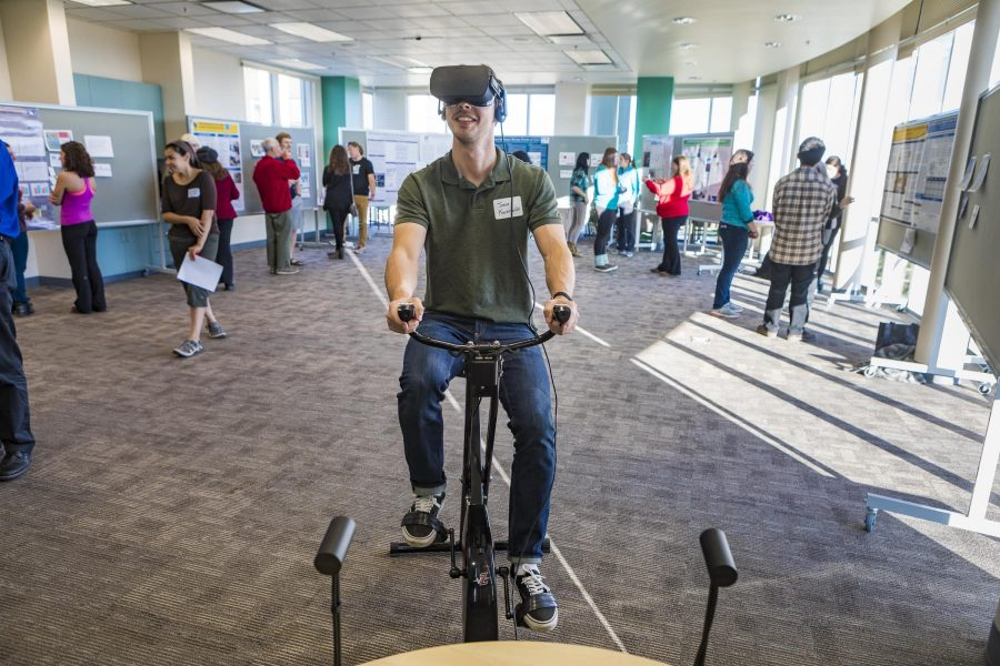 student on stationary bike using virtual reality headset