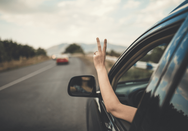 Driving in a car peace sign from Shutterstock