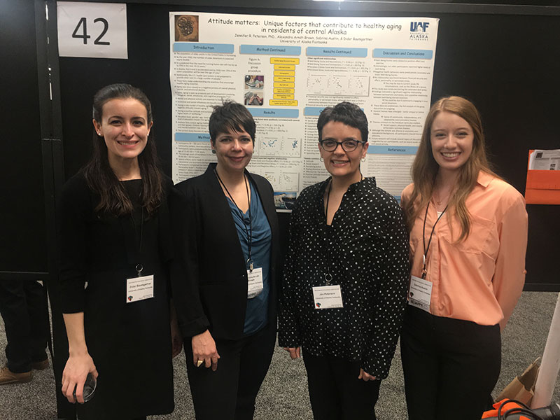 Didar Baumgartner, Alexandra Arndt-Brown, Jen Peterson and Sabrina Austin in front of a research poster at the Western Psychological Association Convention in 2018.