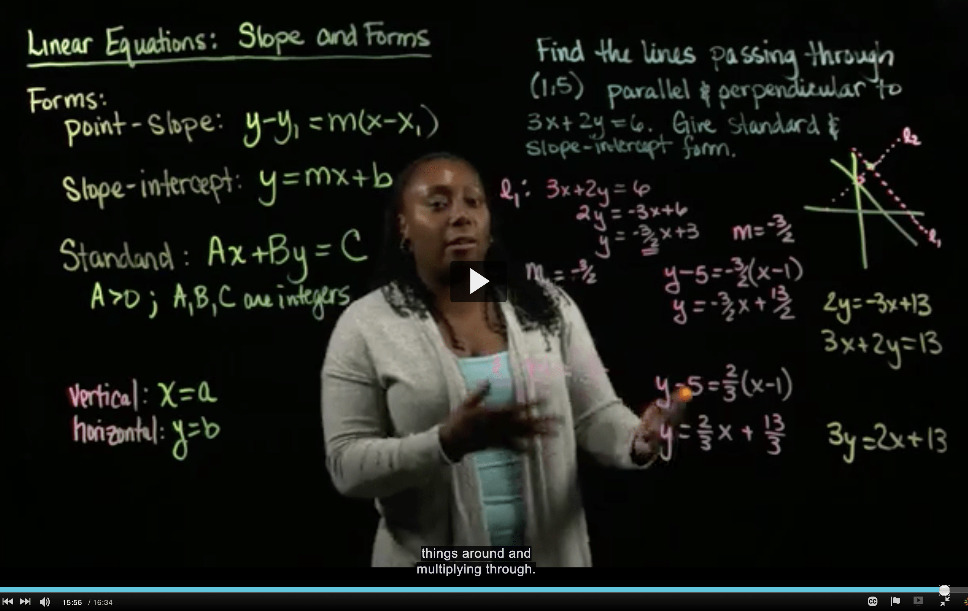 Latrice writing math on a transparent white board.